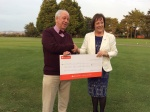 Martyn receives cheque from Golf Club after Brixham Town Band event